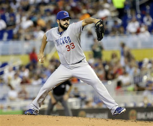 Chicago Cubs' Carlos Villanueva pitches to the Miami Marlins in the first inning of a baseball game in Miami, Sunday, April 28, 2013. (AP Photo/Alan Diaz)