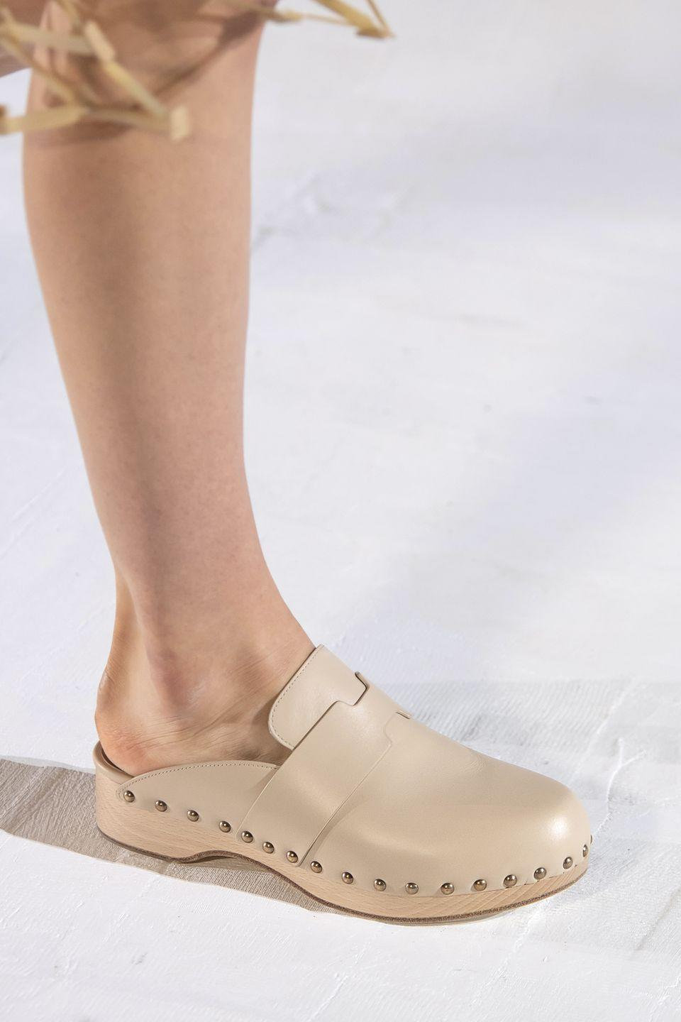<p>Yes, the humble clog is still A Thing—and in 2021, they're all about neutral tones.</p><p><em>Hermes</em></p>