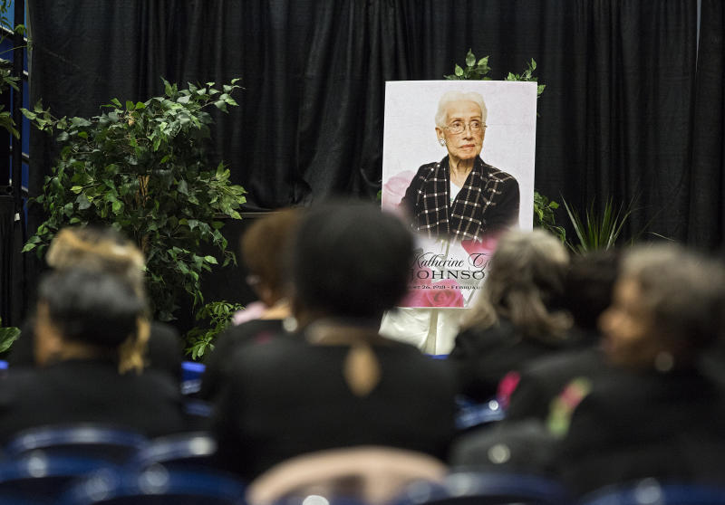 "A portrait of NASA mathematician Katherine Johnson faces guests prior to a memorial service in her honor on Saturday, March 7, 2020, at Hampton University Convocation Center in Hampton, Va.   Johnson, a mathematician who calculated rocket trajectories and earth orbits for NASA's early space missions and was later portrayed in the 2016 hit film ""Hidden Figures,"" about pioneering black female aerospace workers  died on Monday, Feb. 24, 2020. She was 101. (Kaitlin McKeown /The Virginian-Pilot via AP)"