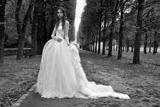 <p><i>Long-sleeve, washed charmeuse halter ball gown with Chantilly lace. (Photo: Courtesy of Vera Wang/Patrick Demarchelier) </i></p>