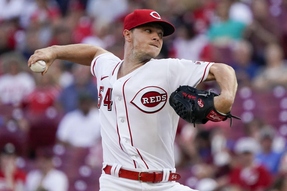 Cincinnati Reds starting pitcher Sonny Gray throws during the first inning of the team's baseball game against the Pittsburgh Pirates in Cincinnati on Thursday, Aug. 5, 2021. (AP Photo/Jeff Dean)