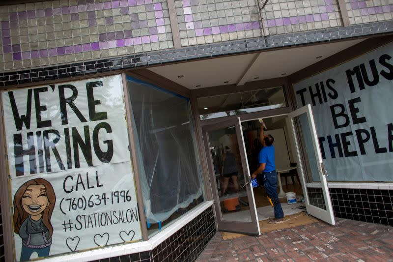 FILE PHOTO: A new business advertises for workers as it prepares to open up during the outbreak of the coronavirus disease in California,
