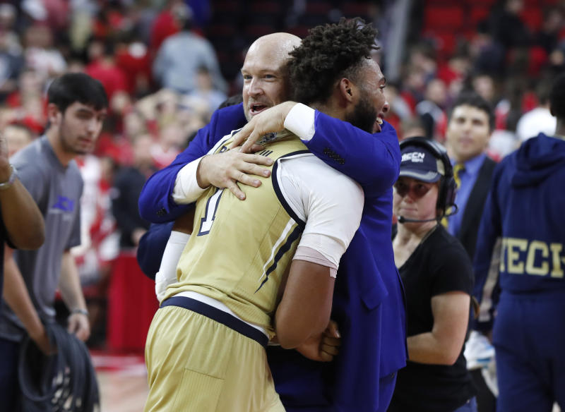 Georgia Tech assistant coach Julian Swartz hugs James Banks III (1) after Georgia Tech's 82-81 overtime victory over North Carolina State in an NCAA college basketball game Tuesday, Nov. 5, 2019, in Raleigh, N.C. (Ethan Hyman/The News & Observer via AP)