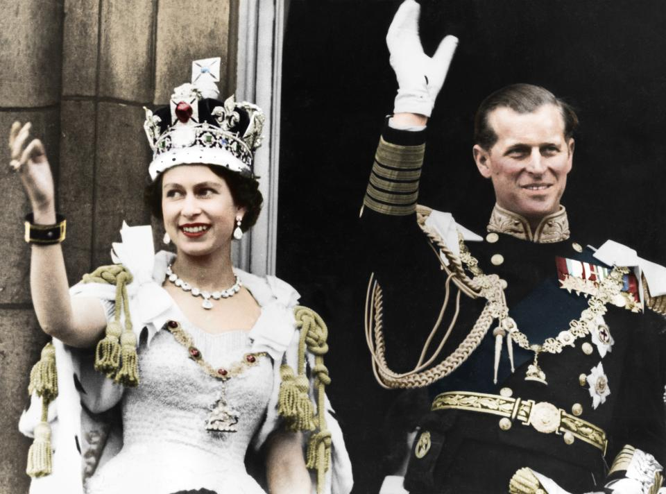 Queen Elizabeth II and the Duke of Edinburgh on the day of their coronation, Buckingham Palace, 1953. (Colorised black and white print). Artist Unknown. (Photo by The Print Collector/Getty Images)