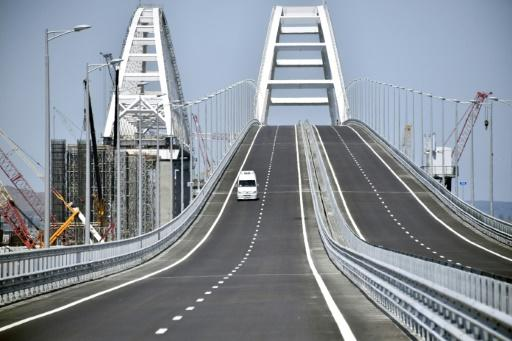 A vehicle passes over the 19 km road-and-rail Crimean Bridge over the Kerch Strait and linking southern Russia to the Crimean peninsula on May 15, 2018, prior to the opening ceremony