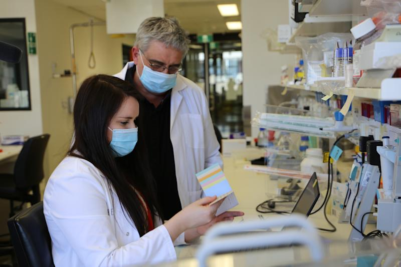 Pictured is researcher Leah Beauchamp and Professor Kevin Barnham from the Florey Institute in a laboratory.
