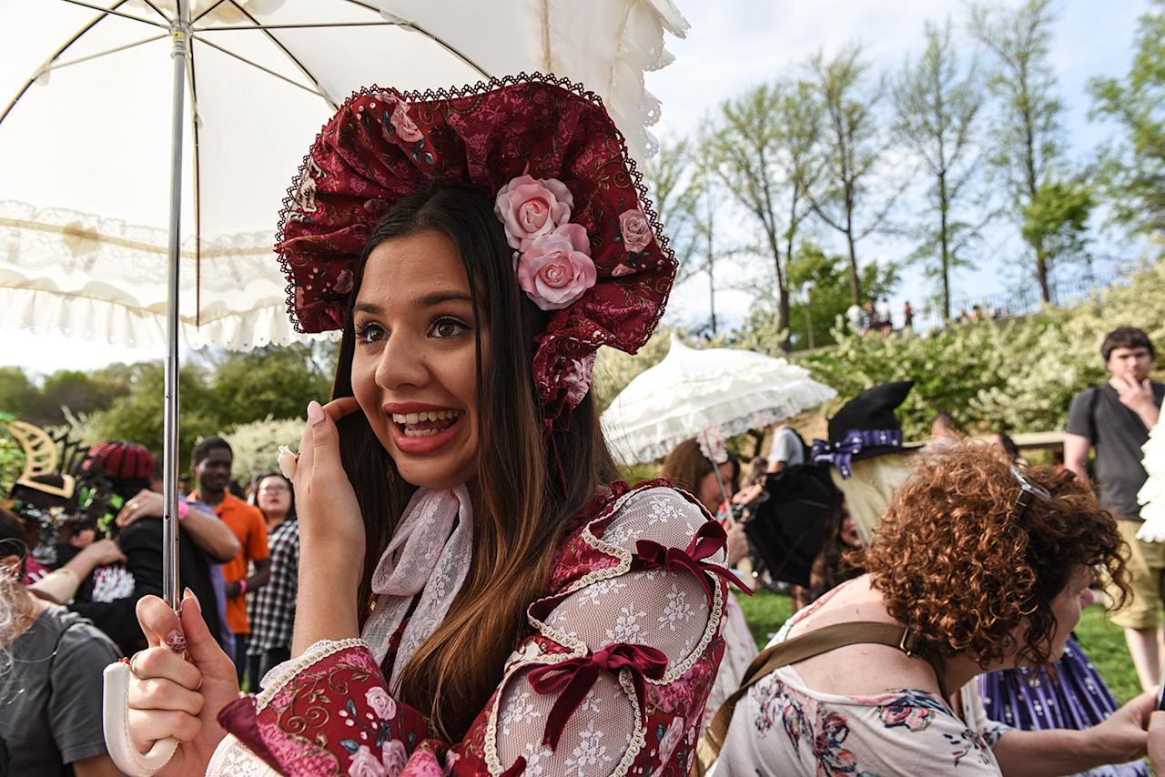 <p>A woman poses for a photo after participating in the BBG Parasol Society Fashion Show, which celebrates Lolita-style fashion, at the Brooklyn Botanic Garden's Cherry Blossom Festival, April 29, 2017, in New York. The Brooklyn Botanic Garden is famous for their cherry blossoms, which typically bloom at the end of April and attract thousands of visitors. (Photo: Stephanie Keith/Getty Images) </p>