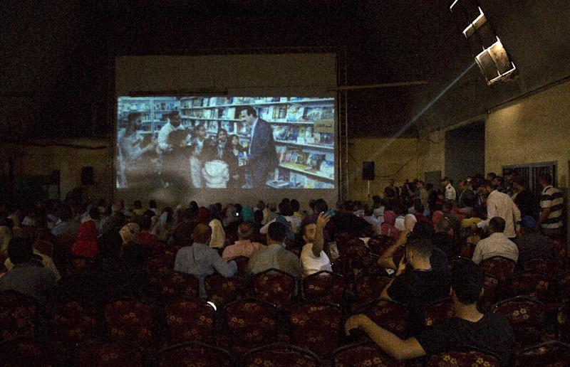 """Palestinians attend the screening of """"10 Years"""" at the Samer Cinema in Gaza City on August 26, 2017"""