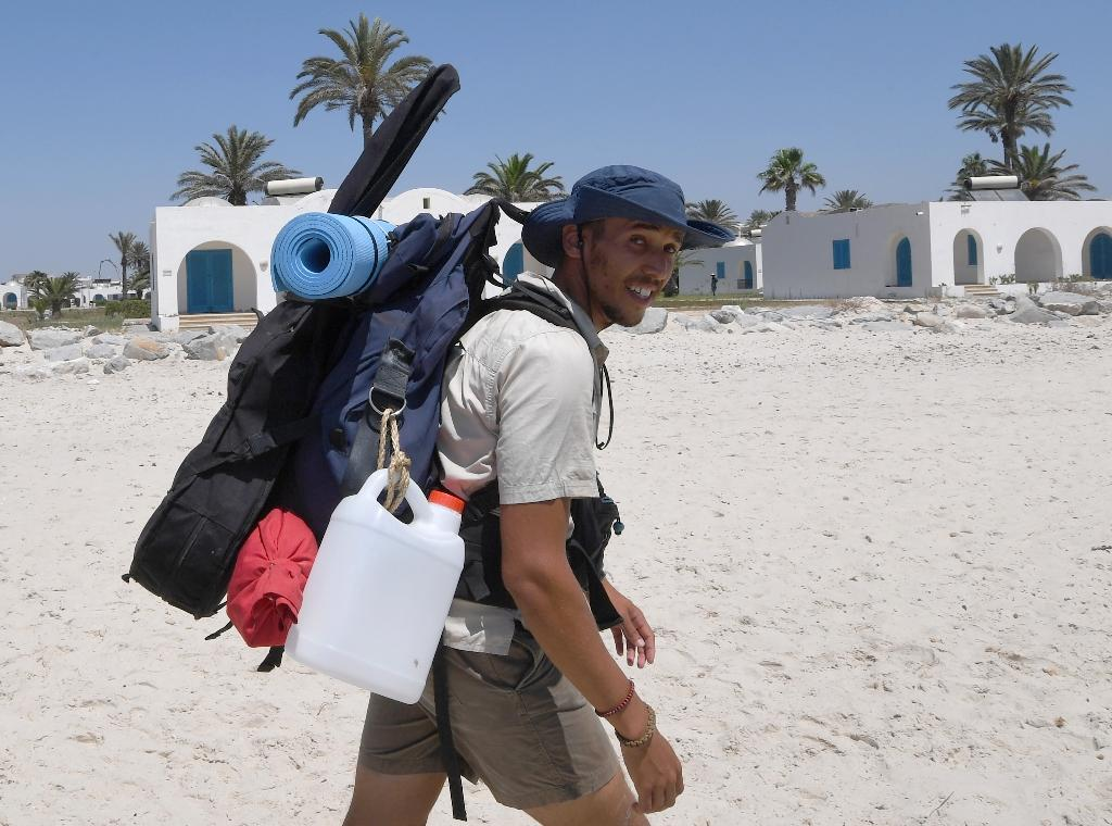 Houij hopes his two-month trek will help convince authorities, holidaymakers and average Tunisians that the sea should not be used as a giant garbage tip (AFP Photo/FETHI BELAID)