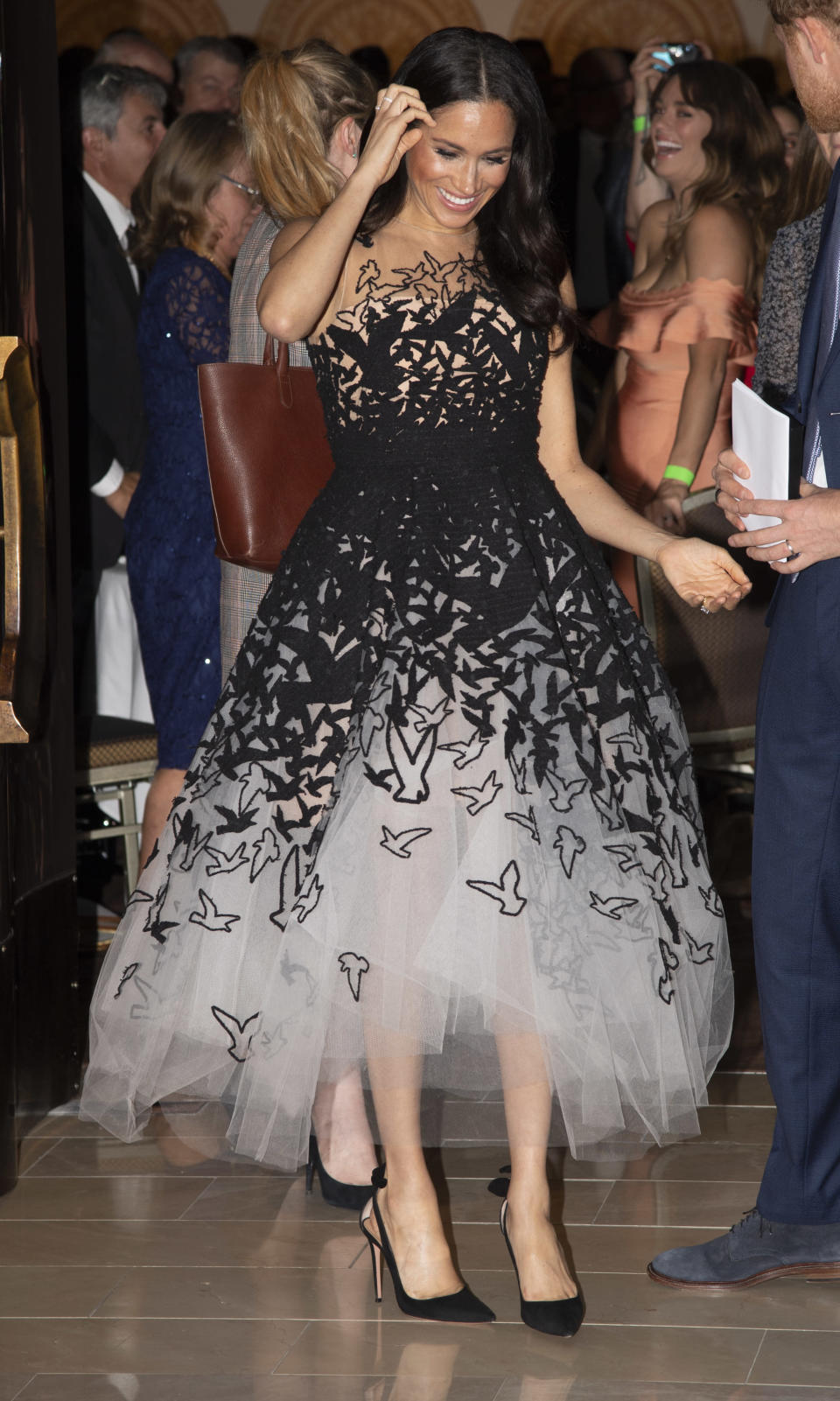 <p>There's no denying that Meghan's Oscar de la Renta dress wins the best fashion moment of the year thanks to its puffed tulle skirt and romantic bird detailing. She finished the ensemble with Hollywood-worthy curls and Tabitha Simmons shoes. <em>[Photo: Getty]</em> </p>