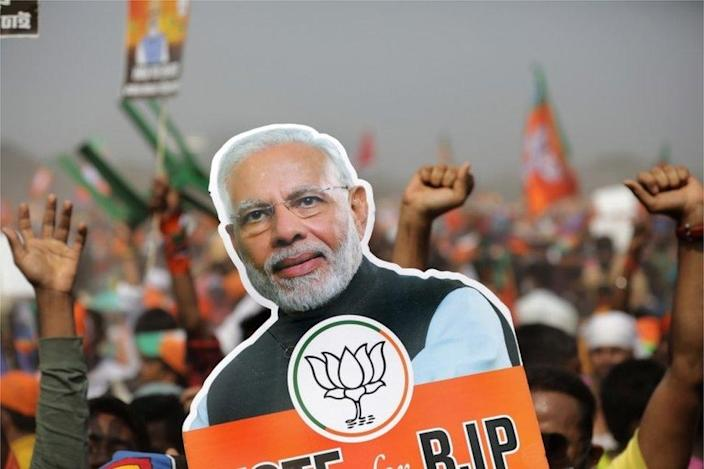 Bharatiya Janata Party (BJP) supporters posted a photo poster of Indian Prime Minister Narendra Modi during a rally on March 7, 2021 at the Brigade Parade Ground in Kolkata, India. I'm waiting.