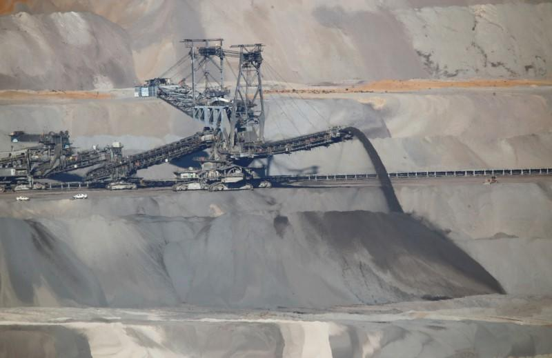 An excavator of German utility RWE works in the open-cast brown coal mining area of Hambach