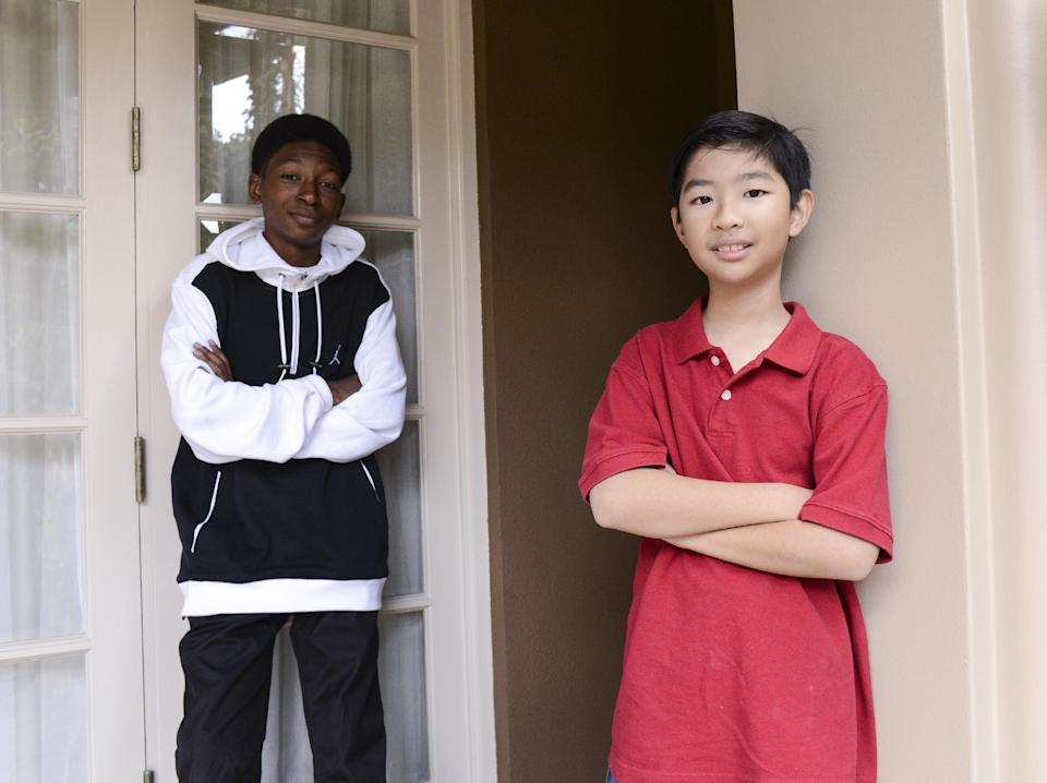 """In this Monday, Oct. 7, 2013 photo, actors Skylan Brooks, left, and Ethan Dizon, from the cast of the feature film """"The Inevitable Defeat of Mister & Pete"""" pose for a portrait together at the Four Seasons Hotel, in Beverly Hills, Calif. For George Tillman Jr., directing 13-year-old Brooks and 11-year-old Dizon, the stars of Lionsgate's coming-of-age drama, meant encouraging them to rival peer Quvenzhane Wallis' performance in """"Beasts of the Southern Wild."""" Evoking the emotions of helpless kids running out of options in the film which hits theaters Friday, Oct. 11, 2013, was something Tillman knew both Brooks and Dizon would be capable of. (Photo by Dan Steinberg/Invision/AP)"""