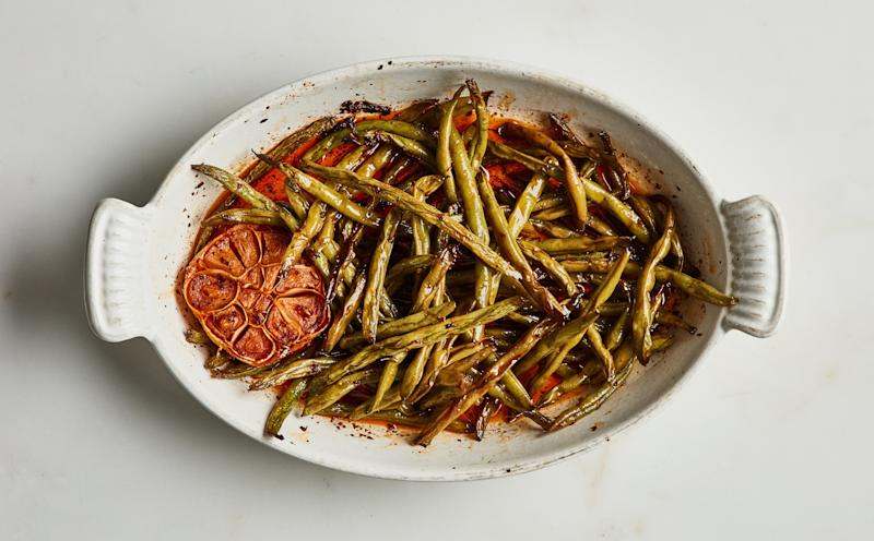 """A """"shallow confit"""" of green beans with harissa and cumin."""
