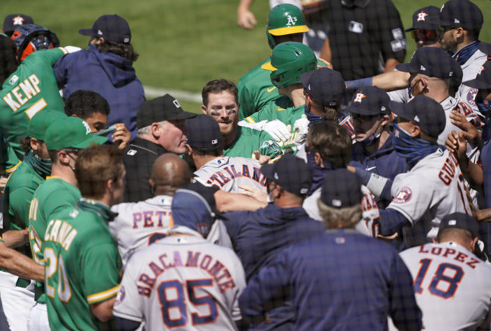 A brawl broke out between the A's and Astros Sunday after Ramon Laureano charged Alex Cintrón in the Astros dugout. (Photo by Thearon W. Henderson/Getty Images)