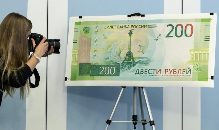 The new 200 ruble note featuring a controversial design including a naval memorial in Sevastopol Crimea is unveiled