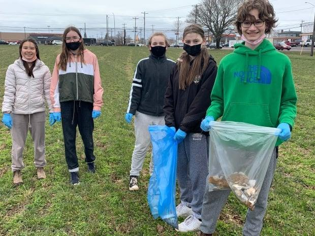 Sam Gillis, right, and other students at Birchwood Intermediate remebered Josh Underhay as a 'great teacher' who cared deeply about the environment. (Laura Meader/CBC - image credit)