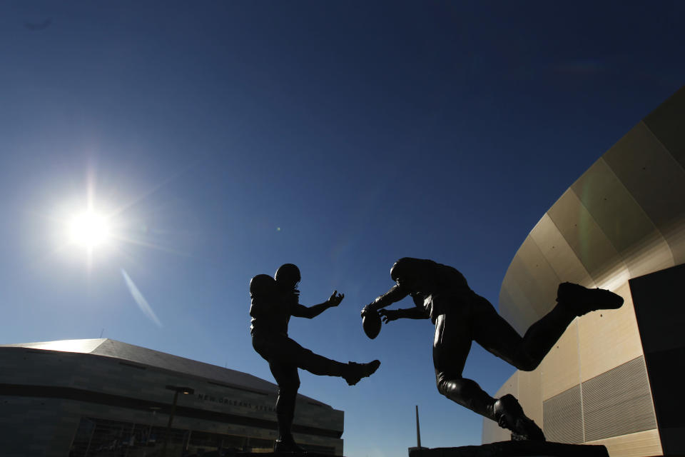 """A bronze statue titled """"Rebirth,"""" outside the Mercedes-Benz Superdome, depicts former New Orleans Saint Steve Gleason blocking a punt against the Atlanta Falcons during the first """"Monday Night Football"""" game, after the Superdome re-opened following Hurricane Katrina. (AP)"""