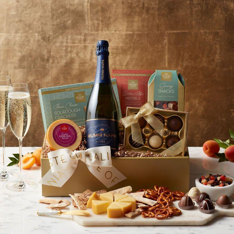 """<p>hickoryfarms.com</p><p><a href=""""https://go.redirectingat.com?id=74968X1596630&url=https%3A%2F%2Fwww.hickoryfarms.com%2Fgift-baskets%2Fwine%2Fmumm-napa-sparkling-wine-gift-box-007661.html&sref=https%3A%2F%2Fwww.townandcountrymag.com%2Fleisure%2Fdining%2Fg29328884%2Fbest-wine-cheese-gift-baskets%2F"""" rel=""""nofollow noopener"""" target=""""_blank"""" data-ylk=""""slk:Shop Now"""" class=""""link rapid-noclick-resp"""">Shop Now</a></p><p>One gift no one is every disappointed with? Sparkling wine. And to make things even better, this basket not only comes with a bottle of California sparkler, but also a smoked gouda, butter toffee pretzels, three cheese crackers, truffles, and snack mix for all their noshing needs. </p>"""