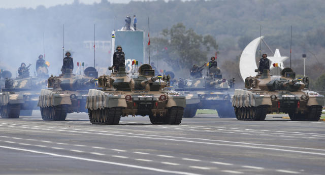 Pakistani-made tanks roll down during a military parade to mark Pakistan National Day, in Islamabad, Pakistan, Saturday, March 23, 2019. Pakistanis are celebrating their National Day with a military parade that's showcasing short- and long-range missiles, tanks, jets, drones and other hardware. (AP Photo/Anjum Naveed)