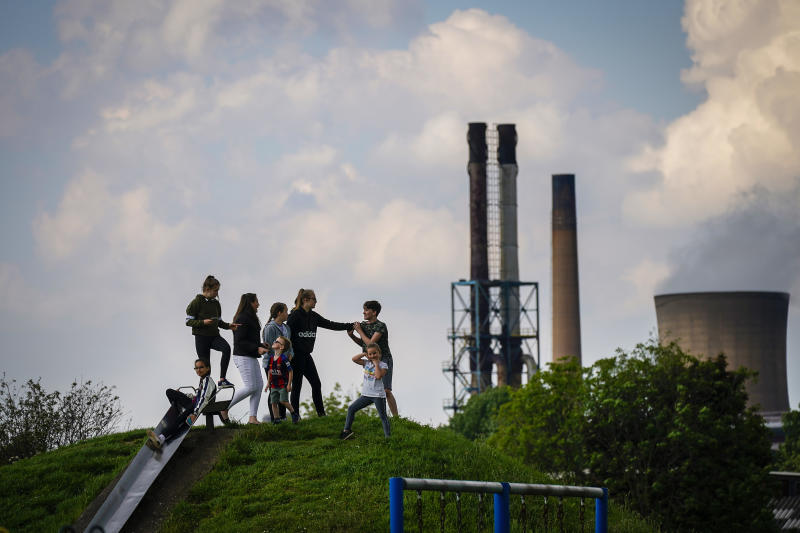 SCUNTHORPE, ENGLAND - MAY 22: Children play in park against the backdrop of British Steel's Scunthorpe works which has been forced into liquidation today on May 22, 2019 in Scunthorpe, England. The High Court in London has ordered British Steel Limited into compulsory liquidation. (Photo by Christopher Furlong/Getty Images)