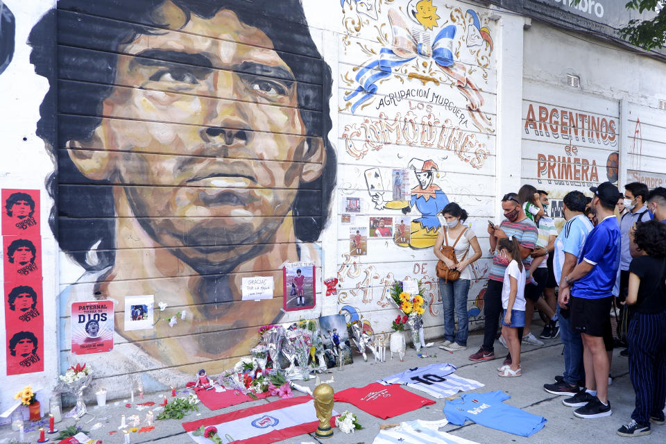 Fans mourn Diego Maradona in an altar outside Argentinos Juniors' Diego Maradona Stadium in Buenos Aires, Argentina. Diego Maradona, considered one of the biggest football stars in history, died at 60 from a heart attack on Wednesday in Buenos Aires.