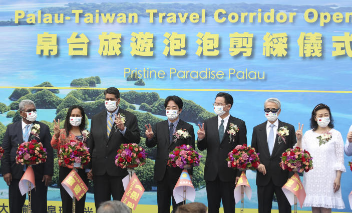 Palau President Surangel Whipps, third from left, and Taiwan's Vice President William Lai, center, attend a ceremony of the opening of the Palau-Taiwan Travel Corridor in Taipei, Taiwan, Tuesday, March 30, 2021. The Palau-Taiwan Travel Corridor, which allows people to travel between the islands without a COVID-19 quarantine, will start on April 1. (AP Photo/Chiang Ying-ying)