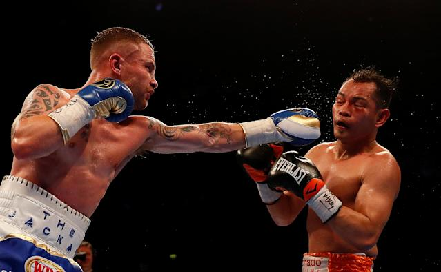 Boxing - Carl Frampton v Nonito Donaire - WBO Interim Featherweight World Title - SSE Arena, Belfast, Britain - April 21, 2018 Carl Frampton in action with Nonito Donaire Action Images via Reuters/Jason Cairnduff