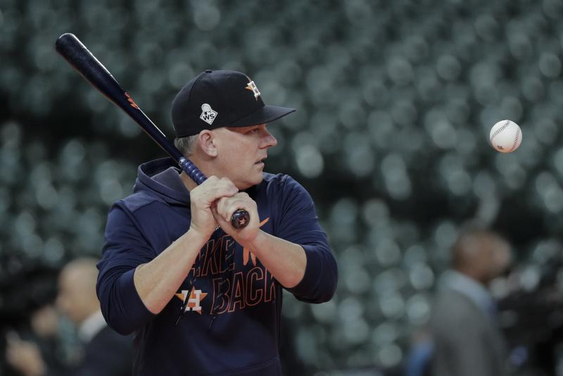 Houston Astros manager AJ Hinch hits balls during batting practice before Game 7 of the baseball World Series against the Washington Nationals Wednesday, Oct. 30, 2019, in Houston. (AP Photo/David J. Phillip)