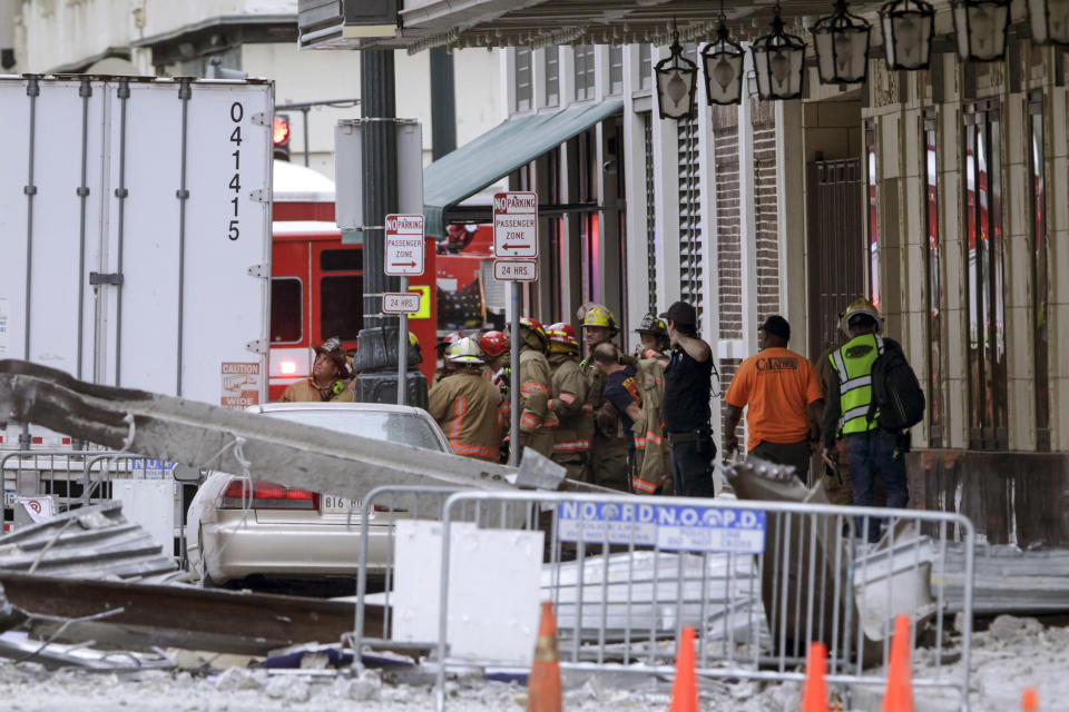 Construction workers are helped by emergency personnel after a large portion of a hotel under construction suddenly collapsed in New Orleans on Saturday, Oct. 12, 2019. Several construction workers had to run to safety as the Hard Rock Hotel, which has been under construction for the last several months, came crashing down. It was not immediately clear what caused the collapse or if anyone was injured. (Scott Threlkeld/The Advocate via AP)