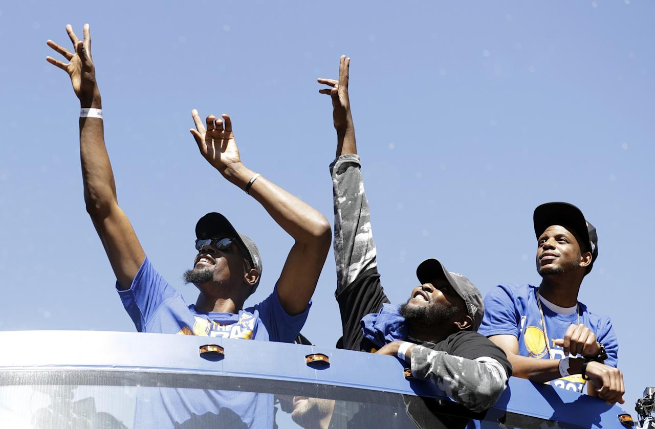 <p>Golden State Warriors' Kevin Durant, top left, during a parade and rally after winning the NBA basketball championship Thursday, June 15, 2017, in Oakland, Calif. (AP Photo/Marcio Jose Sanchez) </p>