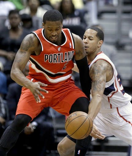 Atlanta Hawks' Devin Harris, right, reaches for the ball as Portland Trail Blazers' Wesley Matthews dribbles in the second quarter of an NBA basketball game, Friday, March 22, 2013, in Atlanta. (AP Photo/David Goldman)