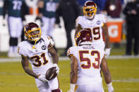 Washington Football Team's Kamren Curl (31) reacts with Jon Bostic (53) after intercepting a Philadelphia Eagles' pass during the first half of an NFL football game, Sunday, Jan. 3, 2021, in Philadelphia. (AP Photo/Chris Szagola)