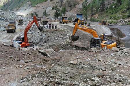 FILE PHOTO: Excavators are used to dig earth at the dam site of Kishanganga power project in Gurez, 160 km (99 miles) north of Srinagar June 21, 2012. REUTERS/Fayaz Kabli/File Photo