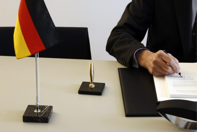 Peter Gottwald, German ambassador in Switzerland, unseen, and Michael Ambuehl, Switzerland's State Secretary for International Financial and Tax Matters, sign an additional protocol on a tax agreement between Germany and Switzerland in Bern, Switzerland, Thursday, April 5, 2012. (AP Photo/Keystone/Peter Klaunzer)