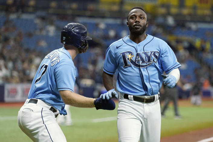 Tampa Bay Rays' Randy Arozarena, right, and Austin Meadows celebrate after scoring on an error by New York Yankees' Brett Gardner during the sixth inning of a baseball game Thursday, July 29, 2021, in St. Petersburg, Fla. (AP Photo/Chris O'Meara)