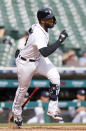 Detroit Tigers' Niko Goodrum breaks for first base with an RBI-single to give the Tigers a 3-2 lead over the Chicago White Sox during the seventh inning of a baseball game Tuesday, Sept. 21, 2021, in Detroit. The Tigers defeated the White Sox 5-3. (AP Photo/Duane Burleson)
