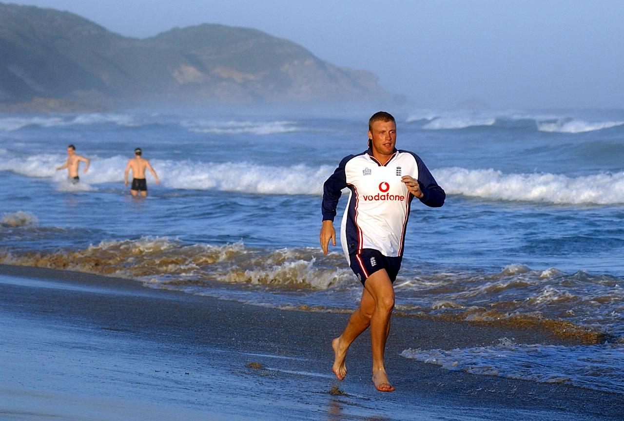 EAST LONDON - FEBRUARY 7:   Andrew Flintoff of England goes for an early morning run in the sea at East London, South Africa on February 7, 2003. (Photo by Tom Shaw/Getty Images)