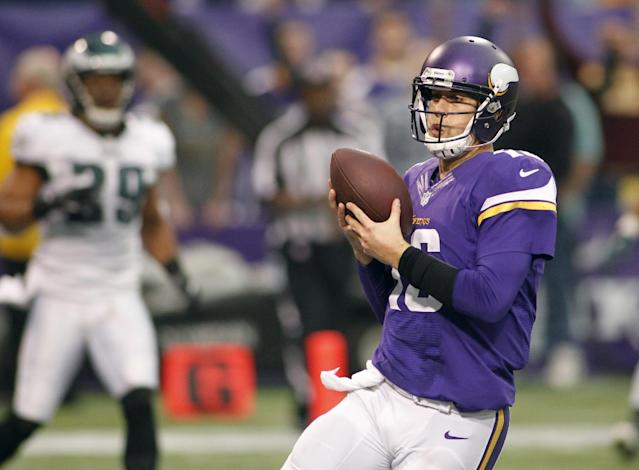 Minnesota Vikings quarterback Matt Cassel scores on a 6-yard touchdown run during the second half of an NFL football game against the Philadelphia Eagles, Sunday, Dec. 15, 2013, in Minneapolis. (AP Photo/Andy King)