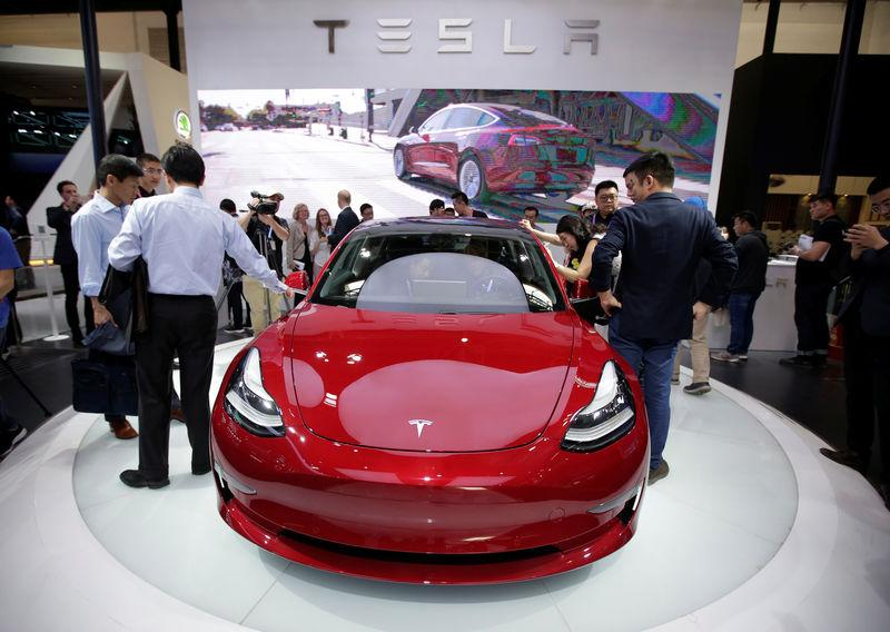A Tesla Model 3 car is displayed during a media preview at the Auto China 2018 motor show in Beijing
