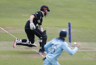 New Zealand's captain Kane Williamson makes his ground as Joe Root attempts a run out. (AP Photo/Alastair Grant)