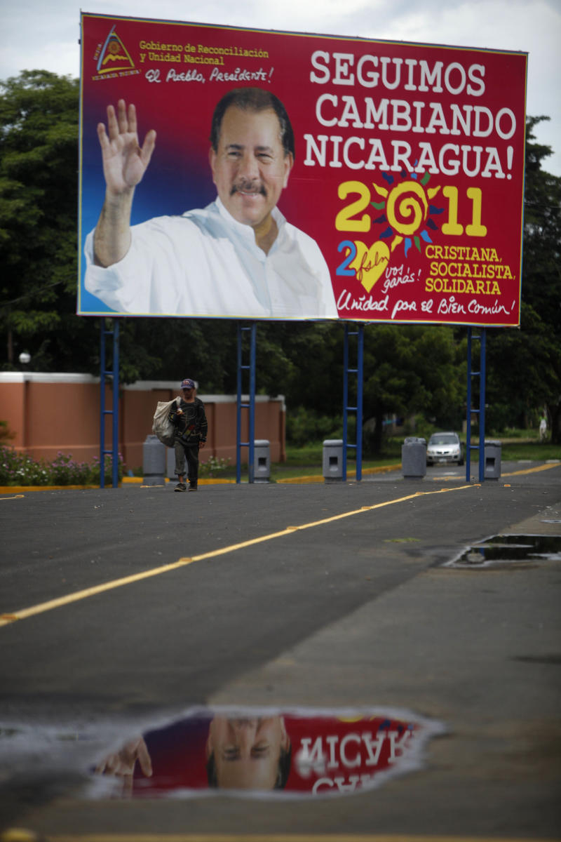 """In this photo taken Aug. 12, 2011, a man walks past presidential election propaganda supporting Nicaragua's current President Daniel Ortega that reads in Spanish """"We keep changing Nicaragua! 2011. Christian, socialist, solidarity."""" Unity for the common good!"""" in Revolution Square in Managua, Nicaragua.  Ortega is running for a third term in presidential elections scheduled for Nov. 6. (AP Photo/Esteban Felix)"""