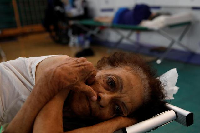 Hilda Colon wakes up after sleeping in a shelter set up at the Pedrin Zorrilla coliseum, after Hurricane Maria destroyed the region in San Juan, Puerto Rico. (Carlos Garcia Rawlins / Reuters)