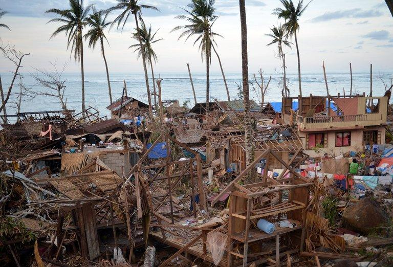 Destroyed houses on December 10, 2012 in Boston in the Philippines' Davao Oriental province after Typhoon Bopha hit