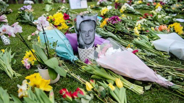 PHOTO: A photo of Prince Philip stands among tributes to Duke Of Edinburgh at Windsor Castle, April 10, 2021. (Chris J Ratcliffe/Getty Images)