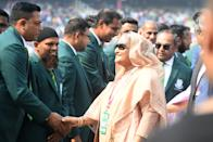 Bangladesh's Prime Minister Sheikh Hasina (C) greets the former players and captains of Bangladesh cricket team before the start of the first day of the second Test cricket match of a two-match series between India and Bangladesh at The Eden Gardens cricket stadium in Kolkata on November 22, 2019. (Photo by Dibyangshu SARKAR / AFP) / IMAGE RESTRICTED TO EDITORIAL USE - STRICTLY NO COMMERCIAL USE