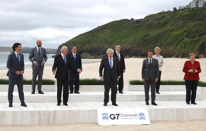 Leaders of the G7 pose for a group photo on overlooking the beach at the Carbis Bay Hotel in Carbis Bay, St. Ives, Cornwall, England, Friday, June 11, 2021. Leaders from left, Canadian Prime Minister Justin Trudeau, European Council President Charles Michel, U.S. President Joe Biden, Japan's Prime Minister Yoshihide Suga, British Prime Minister Boris Johnson, Italy's Prime Minister Mario Draghi, French President Emmanuel Macron, European Commission President Ursula von der Leyen and German Chancellor Angela Merkel. (Phil Noble, Pool via AP)