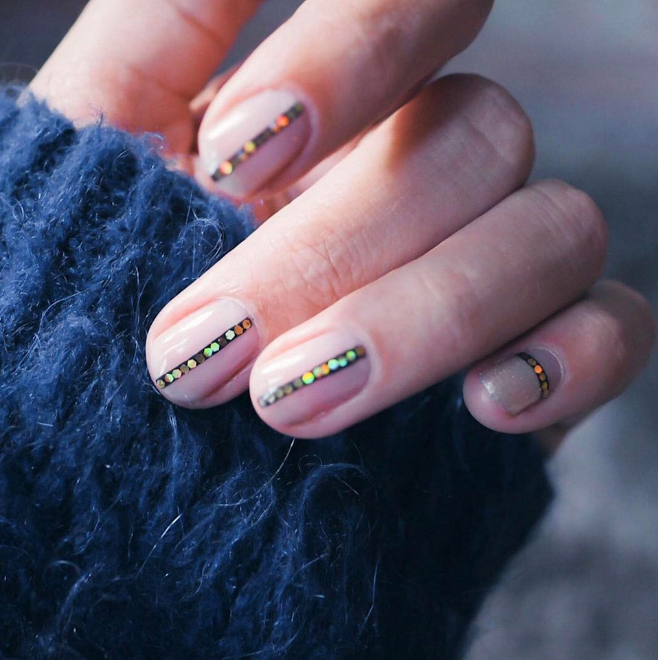 Just add a streak of light-catching sparkle, and you're set with a statement manicure with zero hassle.