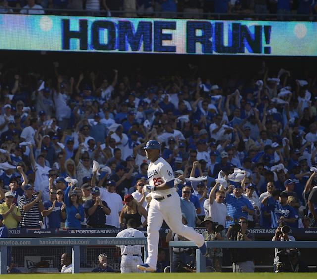 Los Angeles Dodgers' Carl Crawford rounds the bases after hitting a home run during the fifth inning of Game 5 of the National League baseball championship series against the St. Louis Cardinals Wednesday, Oct. 16, 2013, in Los Angeles. (AP Photo/Mark J. Terrill)