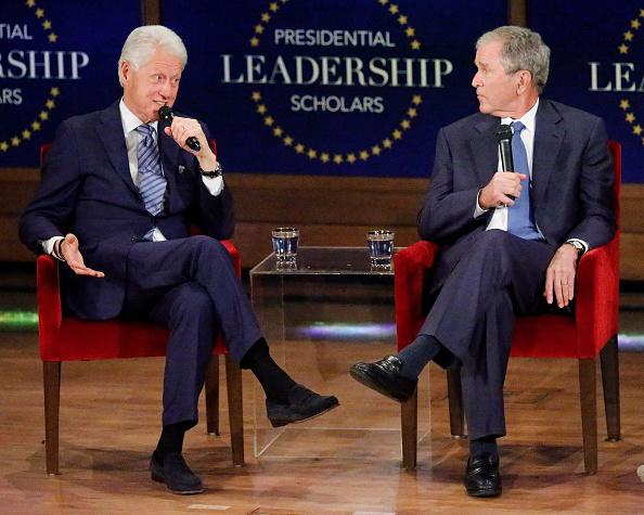 The Internet Is Losing It Over This Photo of Bill Clinton Posing Between Two George Bush Statues – Yahoo News